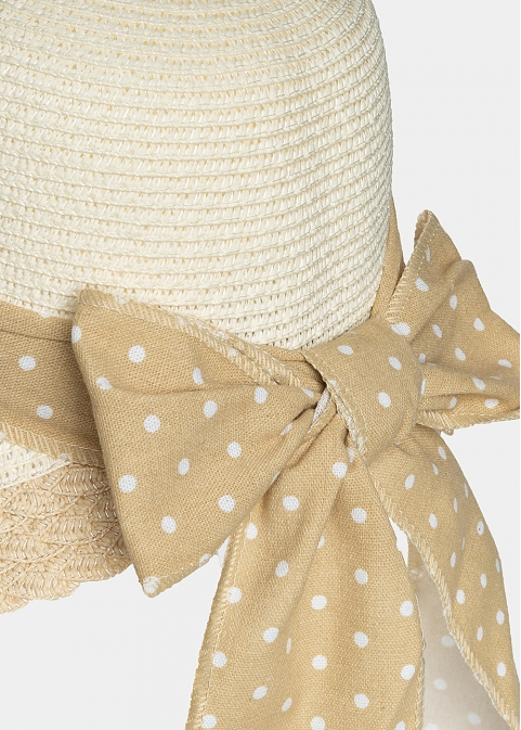 White, lady's hat with beige dotted ribbon